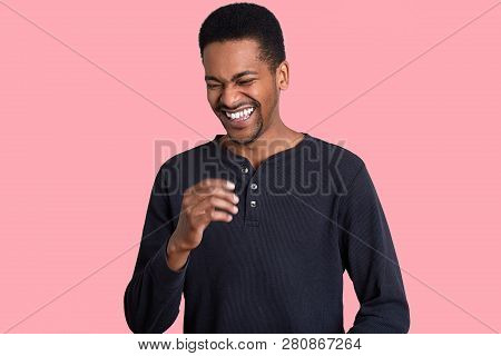 People, Emotions And Ethnicity Concept. Dark Skinned Man Laughs Positively, Shows White Teeth, Cant