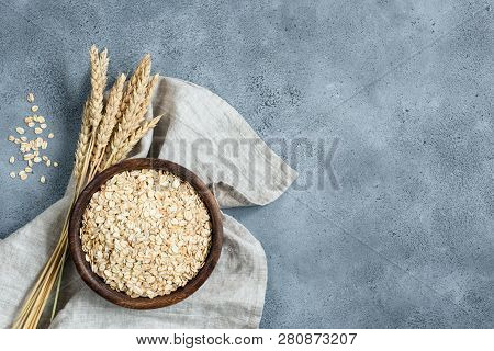 Oats, Oat Flakes, Rolled Oats In Wooden Bowl. Concept Of Healthy Eating, Dieting, Healthy Lifestyle