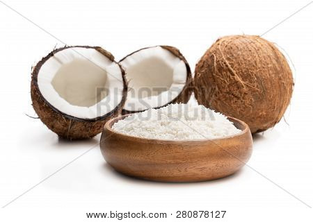 Desiccated  Coconut In Wooden Bowl Isolated On White