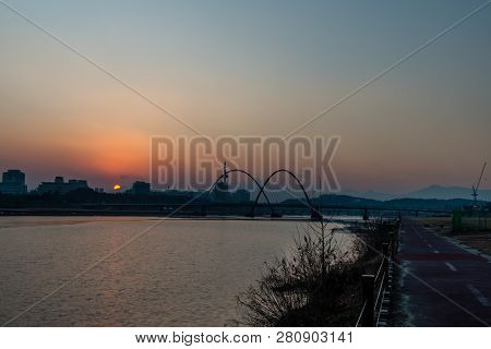 Daejeon,south Korea; January 17, 2019; Bridge And Double Arches In  Expo River Park With Sun Setting