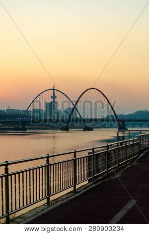 Daejeon,south Korea; January 17, 2019;  Bridge And Double Arches At Expo River Park In Early Evening