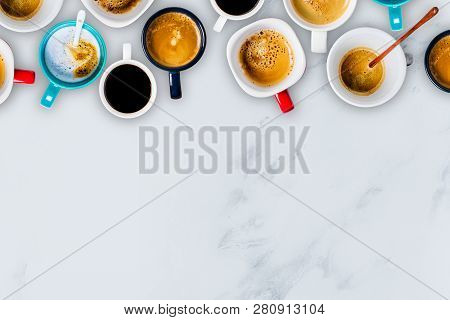 Many Cups Of Coffee On White Marble Background. Top View