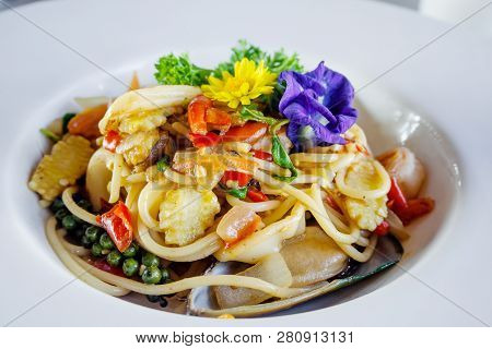 Stir-fried Spicy Spaghetti With Seafoods In White Dish
