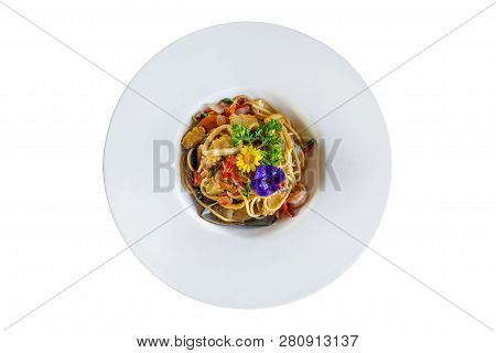 Stir-fried Spicy Spaghetti With Seafoods On White Background.