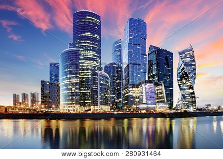 Skyscrapers Of Moscow City Business Center And Moscow River In Moscow At Night, Russia. Architecture