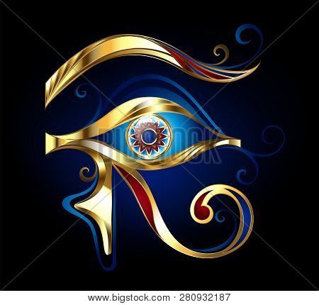 Amulet Eye Of Horus Of Glittering Gold, Decorated With Red And Blue Enamel On Dark Blue Background.