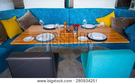 Modern Blue Dining Room, There Are Chairs And Table Setup With Fancy Items. Elegant Table Set In Mod