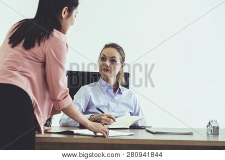 Businesswoman Executive Is In Meeting Discussion With Another Businesswoman In Modern Workplace Offi