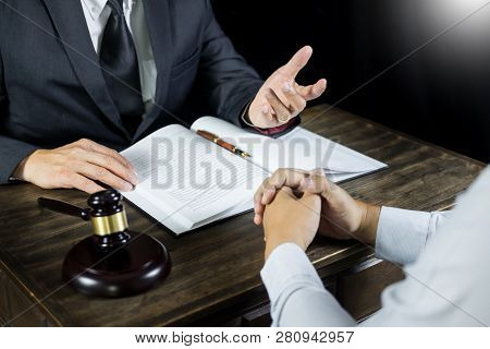 Lawyer Or Judge Consult Meeting With Client At A Law Firm About Legal Legislation In Courtroom With
