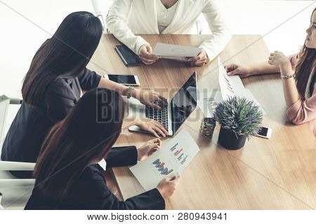 Businesswomen In Meeting, Laptop Computer On Table