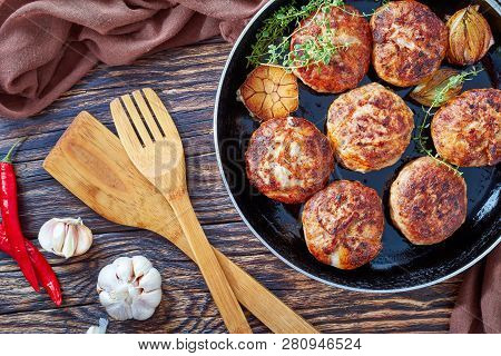Homemade Fried Meat Cutlets, Patties, Turkey Meat Cakes Of Chopped Meat In A Skillet With Thyme, Gar