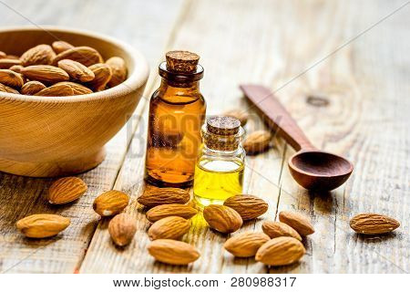 Spa With Almond Oil In Organic Cosmetic Set On Wooden Background