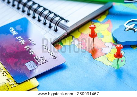 Traveling Concept With Credit Card On Map Background