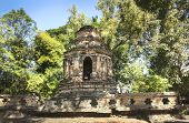 Ruins of the Animisa chedi, with beautiful trees behind it. From Wat Chet Yot, in Chiang Mai. poster