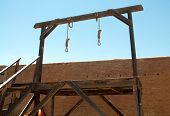 nooses hanging from a gallows poster