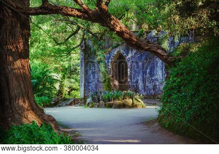 Sintra, Portugal - February 5, 2019: Ancient Ruined Roofless Chapel In The Botanical Park Of Monserr