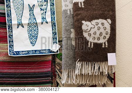 Many Traditional Portuguese Wool Scarves And Cotton Cloth With Sheeps And Sardines Decorations