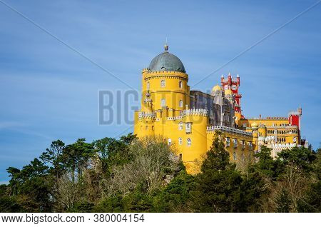 Sintra, Portugal - February 4, 2019: Far Distant Exterior View Of The Pena Palace, Famous Colorful C