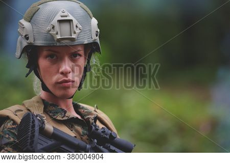 woman soldier ready for battle wearing protective military gear and weapon