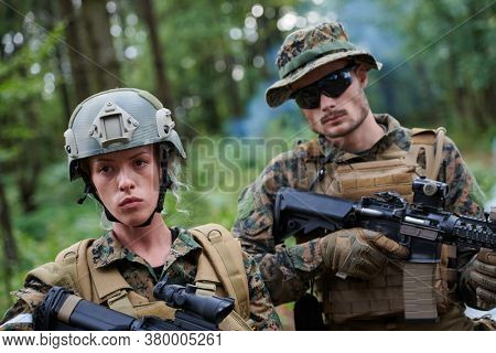 Modern Warfare Soldiers Squad Running in Tactical Battle Formation Woman as a Team Leader