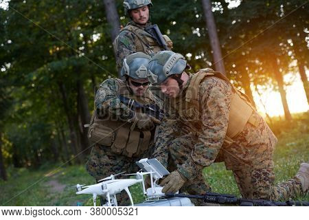Modern Warfare Soldiers Squad are Using Drone for Scouting and Surveillance During Military Operation in the Forest.
