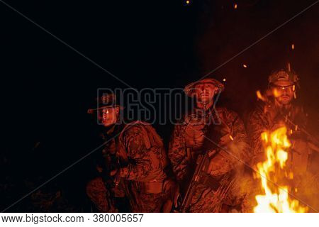 soldiers squad in action on night mission using laser sight beam lights  military team concept