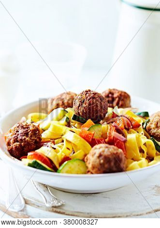 Pappardelle Pasta With Meatballs And Fresh Basil On Bright Background.
