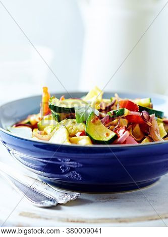 Pappardelle Pasta With Vegetables And Fresh Basil On Bright Wooden Background.