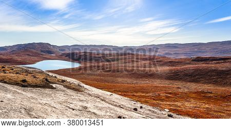 Autumn Greenlandic Orange Tundra Landscape With Lakes And Mountains In The Background, Kangerlussuaq