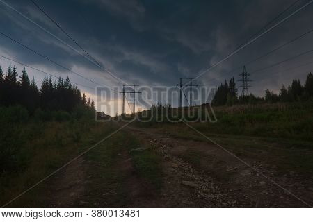 Dramatic Landscape Before Thunderstorm. Stormy Scenery.  Storm Clouds Over The Forest.