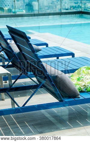 Image Of Swimming Pool With Chaise Loungers Background