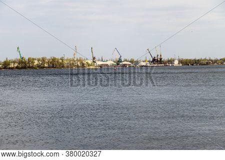 Harbor Cranes At Cargo Port On The River Dnieper In Kremenchug, Ukraine