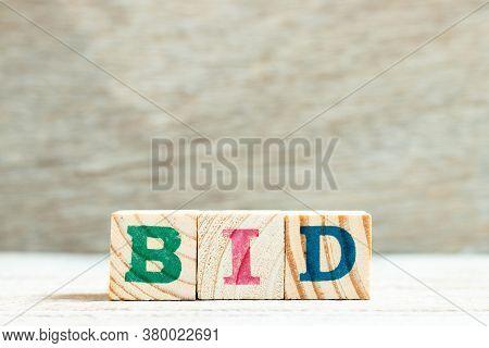 Alphabet Letter In Word Bid On Wood Background