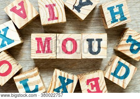 Alphabet Letter Block In Word Mou (abbreviation Of Memorandum Of Understanding) With Another On Wood