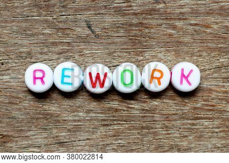 White Bead With Color Letter In Word Rework On Wood Background