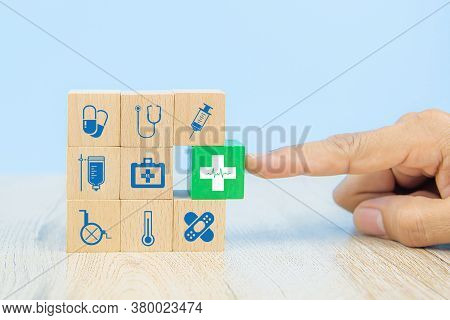 Hand Choose Medical Icon On Cube Wooden Toy Blocks Stack In With Other Medical Symbols Concepts Of I
