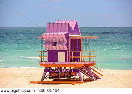 Miami Beach With Lifeguard Tower And Coastline With Colorful Cloud And Blue Sky. World Famous Travel