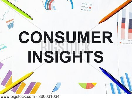 White Piece Of Paper With Text Consumer Insights On The Background Of The Graphs, Multi-colored Felt