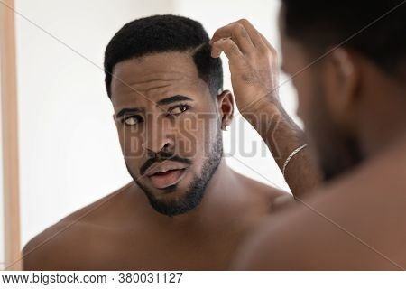 Close Up Anxious Unhappy African American Man Checking Hair