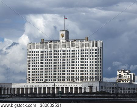 Beautiful View Of The Russian Government House With Flag Against The Blue Sky. Translation: