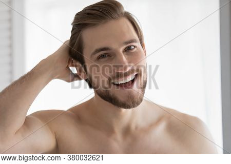 Head Shot Portrait Overjoyed Satisfied Young Man Touching Hair