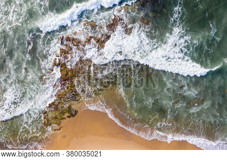 Aerial View Of Waves Breaking Onto Rocks At Dudley Beach - Newcastle Nsw Australia.