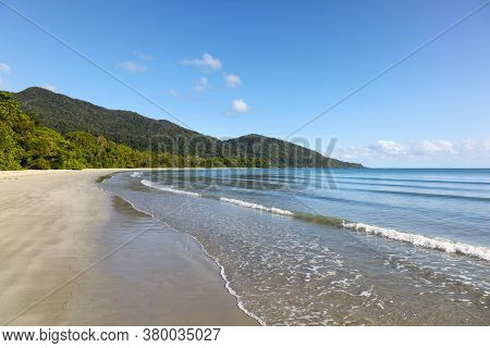 Empty Beach At Cape Tribulation Where The Tropical Rainforest Runs Right To The Shoreline. The Daint