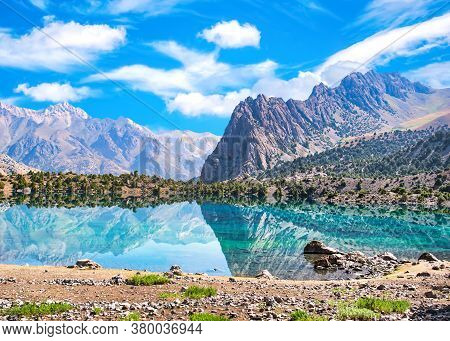 Alaudin Lake With Turquoise Water On A Rocky Mountain Background. Fann Mountains,tajikistan, Central