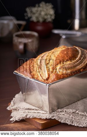 Banana Bread In Loaf Pan. Cake With Banana, Traditional American Cuisine. Whole Loaf.
