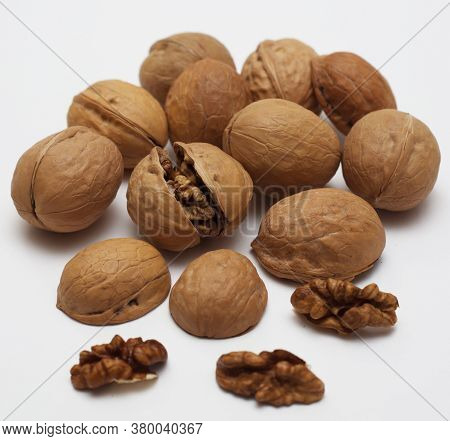 Isolated Walnuts. Broken Walnuts. Tasty Vegan Nuts. Organic Diet Food. Healthy Delicious. Nutshell A