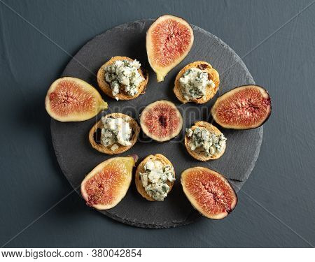 Toast With Roquefort Cheese And Fresh Figs, On A Rustic Background, Top View