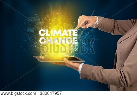 Close-up of a touchscreen with CLIMATE CHANGE inscription, innovative technology concept