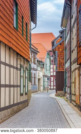Narrow Street With Half Timbered Houses In The Historic Center Of Wernigerode, Germany