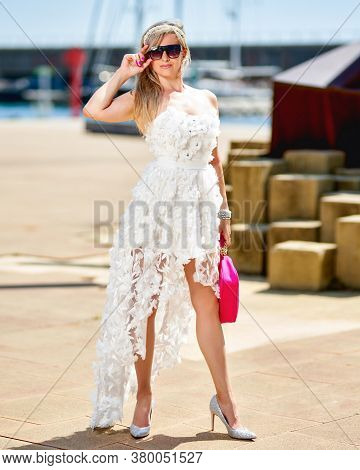 Mature Woman In Fashionable Clothes On The Street